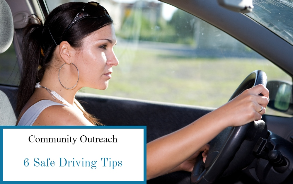 Brunette woman intently watching the road while driving her car, being alert is safe driving tip number one.